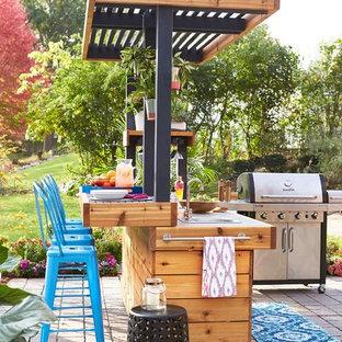 Idee per un patio o portico contemporaneo dietro casa