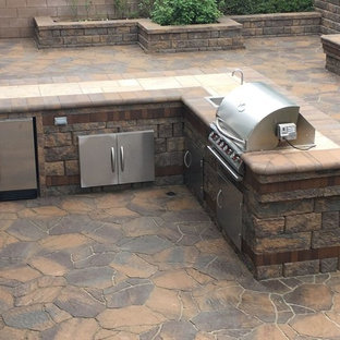 Inspiration for a mid-sized coastal backyard stone patio kitchen remodel in Los Angeles
