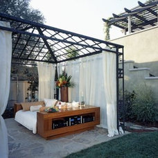 Eclectic Patio by RA Design Group, LLC