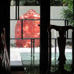 Mid-sized zen courtyard stone patio kitchen photo in Miami with a gazebo