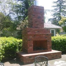 Traditional Patio by Go brick and stone masonry