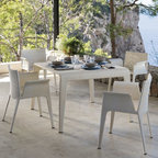 Outdoor Dining Furniture - The contemporary styling of this dining table and chairs is perfect for both casual or formal entertaining.
