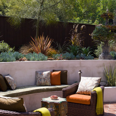 Example of a tuscan tile patio design in Los Angeles with no cover