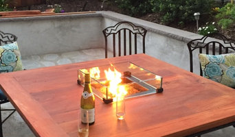 Outdoor dining table with glass enclosed fire pit