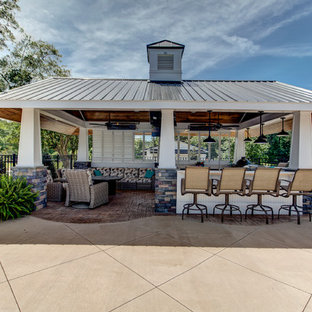 Inspiration for a large nautical back patio in Raleigh with an outdoor kitchen, stamped concrete and a gazebo.