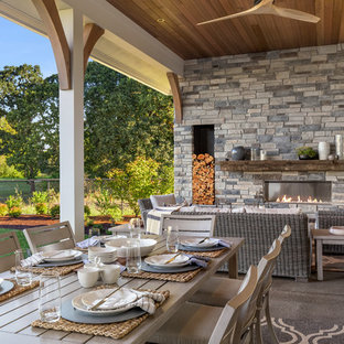 Inspiration For A Farmhouse Concrete Patio Remodel With A Fireplace And A  Roof Extension