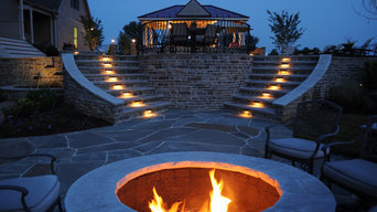 Outdoor fire-pit and path-lit double stone staircase