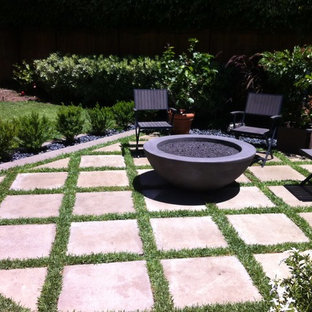 Patio - mid-sized modern backyard concrete paver patio idea in Orange County with a fire pit