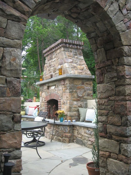 Mediterranean Patio by Poole's Stone and Garden, Inc.