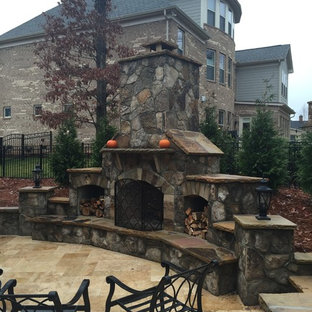 Example of a classic backyard patio kitchen design in Charlotte with no cover
