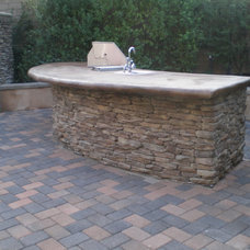 Traditional Patio by Sea Breeze Pavers