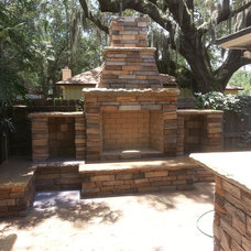 Rustic Patio by A Cut Above Outdoor Specialty Services, Inc.