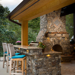 Photo of a rustic back patio in Raleigh with an outdoor kitchen, brick paving and a pergola.