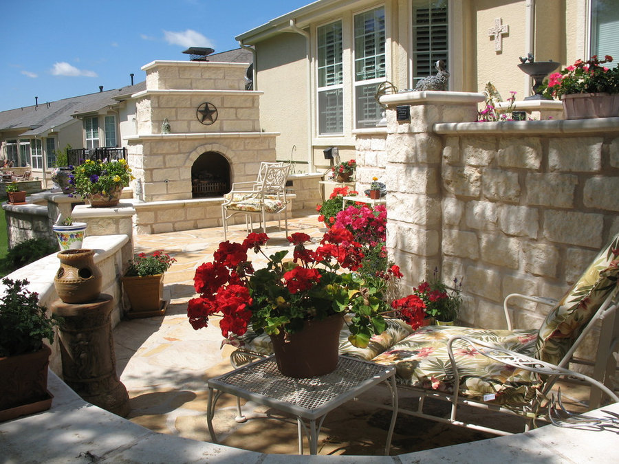 Outdoor gas fireplace on a flagstone patio