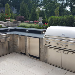 Patio kitchen - large traditional backyard stone patio kitchen idea in DC Metro with no cover