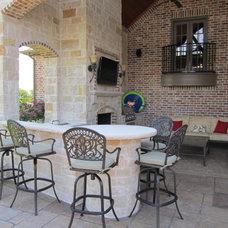 Mediterranean Patio by Garrett Outdoor Living LLC