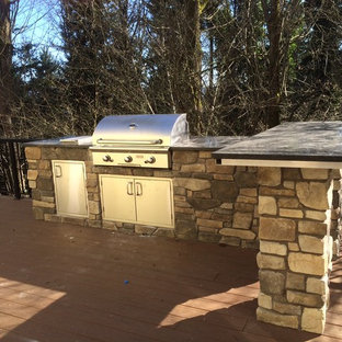 Inspiration for a timeless backyard patio kitchen remodel in Seattle with decking