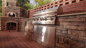 Outdoor kitchen, complete with pizza oven and intricate brick work