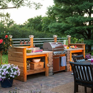Patio kitchen - small industrial backyard brick patio kitchen idea in Other