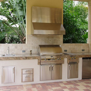 Inspiration for a medium sized mediterranean back patio in Los Angeles with an outdoor kitchen, tiled flooring and a roof extension.