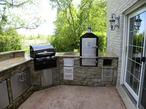 Eclectic Patio by Gordon Kayhart - Custom Design & Installations