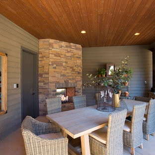 Inspiration for a large timeless backyard concrete patio kitchen remodel in Portland