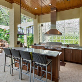 Example of a classic patio kitchen design in Miami with a roof extension
