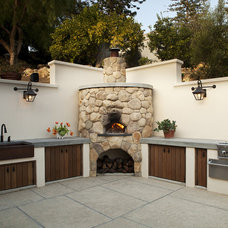 Mediterranean Patio by Poirier + Associates Architects