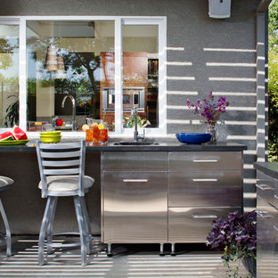 Patio kitchen - contemporary backyard concrete patio kitchen idea in Sacramento with a roof extension