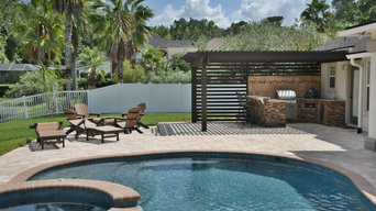 Outdoor kitchen with Solaire infrared grill, Big Green Egg, fire pit and pergola