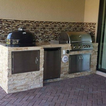 Outdoor Kitchen with Stacked Stone Exterior and Primo Oval