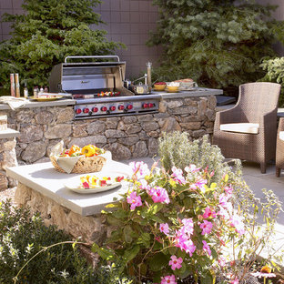 Patio kitchen - mid-sized transitional backyard stone patio kitchen idea in Boston
