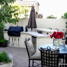 Traditional Patio by Unique Landscapes and Custom Pools