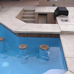 Inspiration for a large backyard stone patio kitchen remodel in Las Vegas with no cover
