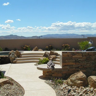 Example of a large backyard concrete paver patio kitchen design in Las Vegas with no cover
