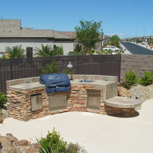 Inspiration for a large backyard concrete paver patio kitchen remodel in Las Vegas with no cover