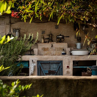 Photo of a medium sized mediterranean back patio in Los Angeles with tiled flooring, no cover and an outdoor kitchen.