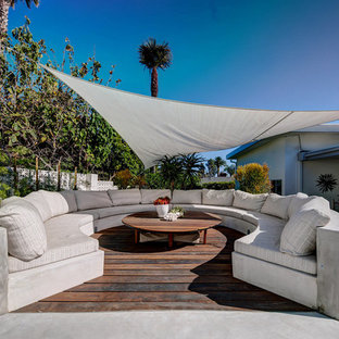 This is an example of a large classic back patio in Los Angeles with an awning.