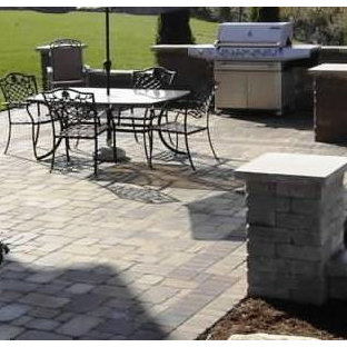 Patio kitchen - small traditional backyard brick patio kitchen idea in Indianapolis