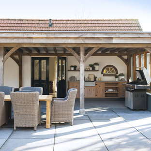 Inspiration for a contemporary patio kitchen remodel in Amsterdam with a pergola