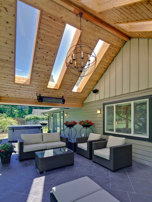 Large Traditional Backyard Tile Patio Idea In Vancouver With A Roof  Extension