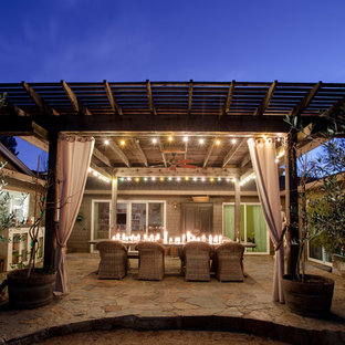 Large country back patio in San Francisco with a pergola.