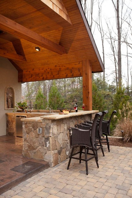 Traditional Patio by Sunmar Construction