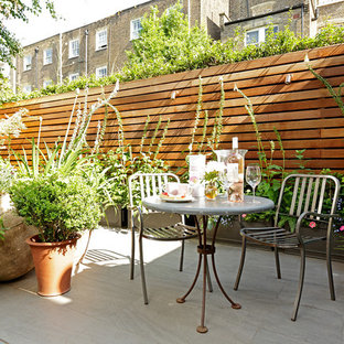 Classic patio in London with no cover and a potted garden.