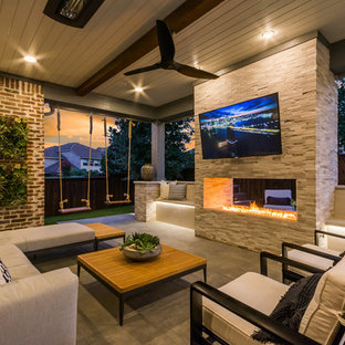 Inspiration for a huge transitional backyard tile patio remodel in Dallas with a roof extension