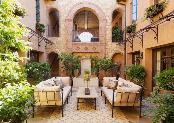 Mediterranean Patio by Kelly Ferm Inc.