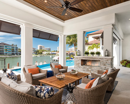 Example Of A Coastal Tile Patio Design In Other With A Fire Pit And A Roof