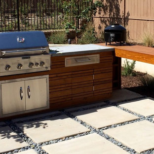 Photo of a medium sized mediterranean back patio in San Diego with an outdoor kitchen and concrete paving.