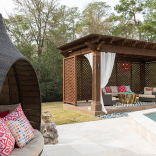 Photo of a contemporary back patio in Houston with stamped concrete and a gazebo.