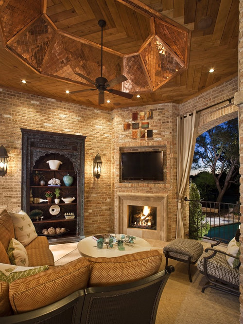 traditional patio idea in dallas with a fire pit and a roof extension